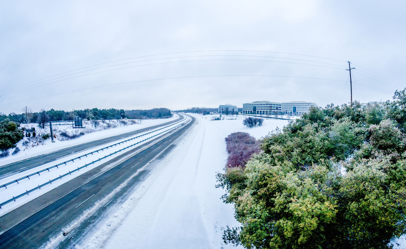 highway covered in snow and sleet without traffic
